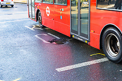 A bus avoids a sunken drain 'pothole' on Station road, pointed out by an off duty bus driver, that could have been a contributing factor to Sunday's bus crash in which 19 people were injured including a teenage girl who is in critical condition. The bus driver was arrested on suspicion of drug driving. Croydon, South London November 12 2018.