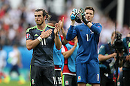 Gareth Bale of Wales and Wayne Hennessey of Wales look on dejected at the end of match after their team team loses.  Euro 2016, group B , England v Wales at Stade Bollaert -Delelis  in Lens, France on Thursday 16th June 2016, pic by  Andrew Orchard, Andrew Orchard sports photography.