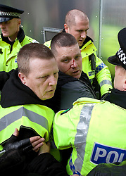 "© under license to London News Pictures. 02/04/2011:A man who attends an EDL rally in Blackburn is rounded on by other EDL supporters and suffers an injury. Stewards and police lead him away for his own safety..About 2000 EDL supporters were in attendance. It was one of the largest policing operations Lancashire police have ever put in to action. Credit should read ""Joel Goodman/London News Pictures""."