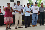 TCGA board member Benita Paquil (left), Q'eqchi' Mayan cacao farmer from San Jose, speaks during the 2013 Annual General Meeting as the newly elected board members are introduced. Toledo Cacao Growers' Association (TCGA), Julian Cho Technical High School, Mile 14 Southern Highway, Toledo, Belize. January 26, 2013.