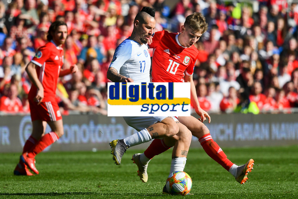 Football - 2018 / 2019 Euro Championship 2020 qualifying round. Wales v SLOVAKIA <br /> <br /> Marek Hamsik tackled by David Brooks of Wales<br /> at Cardiff City Stadium<br /> <br /> COLORSPORT/WINSTON BYNORTH