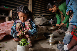 Sumitra, 10, often cooks for the family when the parents are too busy with farming work.<br /> <br /> Niruta and Durga were married 9 years ago, when they were just 14 and 16 years old in the Kagati village of Nepal. The 2015 earthquakes devastated Nepal and left girls and women in an increasingly vulnerable position, leading experts to believe child marriage rates will increase over the coming years.