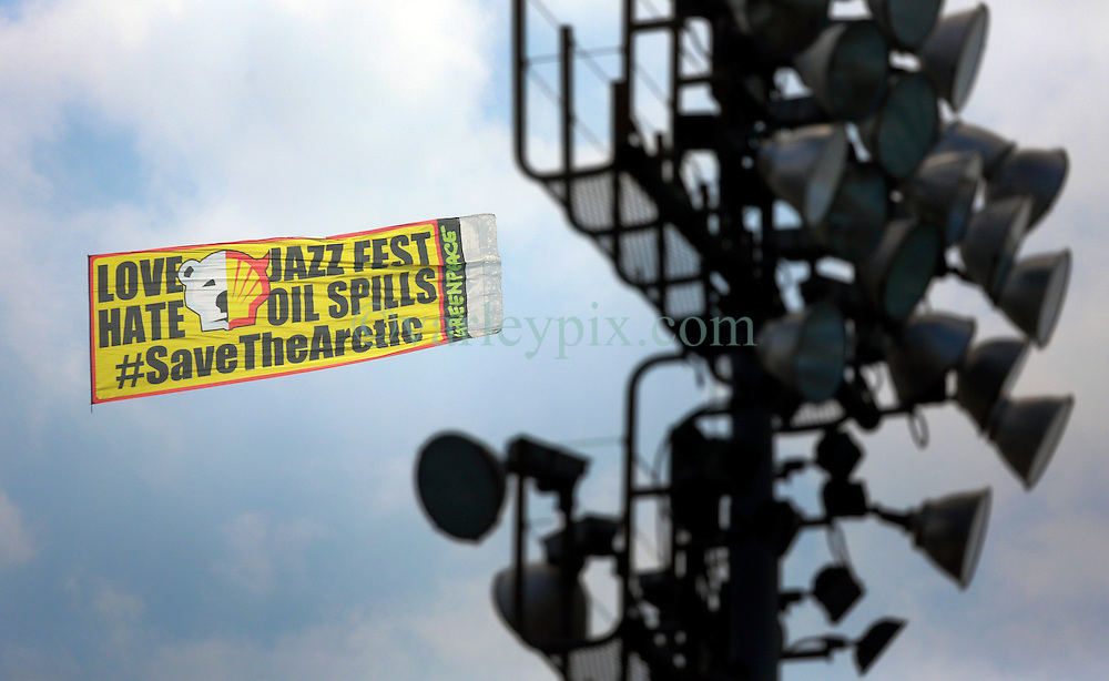 26 April 2014. New Orleans, Louisiana.<br /> Greenpeace hires a plane to pull an aerial banner. 'Love the Jazz Fest - Hate Oil Spills - Save the Arctic.' Shell is a major sponsor of the New Orleans Jazz and Heritage Festival. <br /> Photo; Charlie Varley/varleypix.com