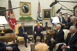 August 28, 2017 - Washington, District of Columbia, United States of America - United States President Donald J. Trump (C) delivers remarks to members of the news media during his meeting with President Sauli Niinisto (L) of Finland in the Oval Office of the White House in Washington, DC, USA, 28 August 2017. Also in the picture is US Secretary of State Rex Tillerson (R) and US Vice President Mike Pence (2-R)..Credit: Michael Reynolds / Pool via CNP (Credit Image: © Michael Reynolds/CNP via ZUMA Wire)