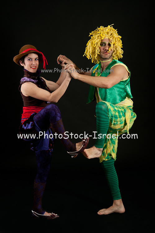 Strangely dressed couple dancing