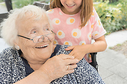 Close-up of grandmother with granddaughter at nursing home, Bavaria, Germany