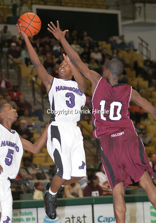 1 December 2008: Zay Jackson (10) of St. Thomas defends Mikel Henry (3) of Hammond during the St. Thomas Falcons 62-44 win over cross town rival the Hammond Tornados at the University Center in Hammond, LA.