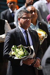 © Licensed to London News Pictures. 22/06/2020. Reading, UK. MP for Reading West ALOK SHARMA joins Faith and community leaders as they lay flowers at Forbury Gardens in Reading town centre where three people were stabbed to death in a terrorist attack. Several other people were injured in the attack which was carried out by Libyan asylum seeker Khairi Saadallah, who is currently in custody. . Photo credit: Ben Cawthra/LNP