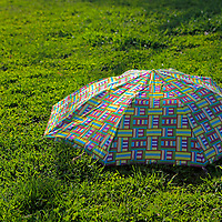 USA, Massachusetts, Boston. Abandoned umbrella at Boston Commons in springtime.