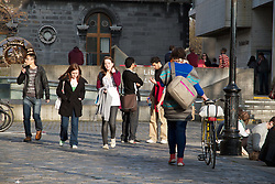 """Trinity College, Dublin formally known as the College of the Holy and Undivided Trinity of Queen Elizabeth near Dublin, was founded in 1592 by letters patent from Queen Elizabeth I as the """"mother of a university"""". .Trinity College is now surrounded by Dublin and is located on College Green, opposite the former Irish Houses of Parliament. The college proper occupies 190,000 m2 (47 acres), with many of its buildings ranged around large quadrangles (known as 'squares') and two playing fields.It is the sole constituent college of the University of Dublin, unlike the universities of Oxford and of Cambridge after which it was modelled and both of which comprise many constituent colleges. .Thus the designations """"Trinity College, Dublin"""" and """"University of Dublin"""" are usually synonymous for practical purposes. Trinity College is one of the seven ancient universities of Britain and Ireland. It is Ireland's oldest university..Originally established outside the city walls of Dublin in the buildings of the dissolved Augustinian Priory of All Hallows, Trinity College was set up in part to consolidate the rule of the Tudor monarchy in Ireland, and it was seen as the university of the Protestant Ascendancy for much of its history; although Roman Catholics and Dissenters had been permitted to enter as early as 1793,certain restrictions on their membership of the college remained until 1873 (professorships, fellowships and scholarships were reserved for Protestants), and the Catholic Church in Ireland forbade its adherents, without permission from their bishop, from attending until 1970. Women were first admitted to the college as full members in 1904.."""