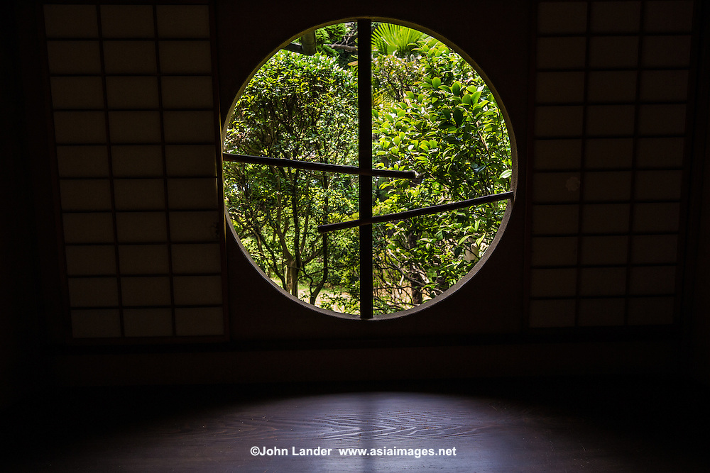 """Washitsu and Moon Window at Tojo-tei Tojogaoka Garden - the former domain of Kokugawa Akitake, often called """"the last Shogun"""".  In 1887 when the last Shogun returned power to the emperor.  At the time,  a new era had begun and people from Shogun families faded into obscurity.  The house was designed in styles of both the Edo and Meiji periods with only precious materials used in its construction.   The minimalism found in the design creates the beauty of form. The garden surrounding the home is  an important element havin been designed so that seasonal followers can be enjoyed viewing from all rooms."""