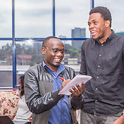 INDIVIDUAL(S) PHOTOGRAPHED: Paul Gitay (left) and Isaac Biosse (right). LOCATION: Shortlist Office, Daykio Plaza, Ngong Road, Nairobi, Kenya. CAPTION: Employees Paul and Isaac stop for a brief chat in Shortlist's office in Nairobi.