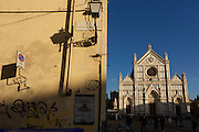 Graffiti street corner and tourist kiosk near Florence's Piazza Santa Croce.