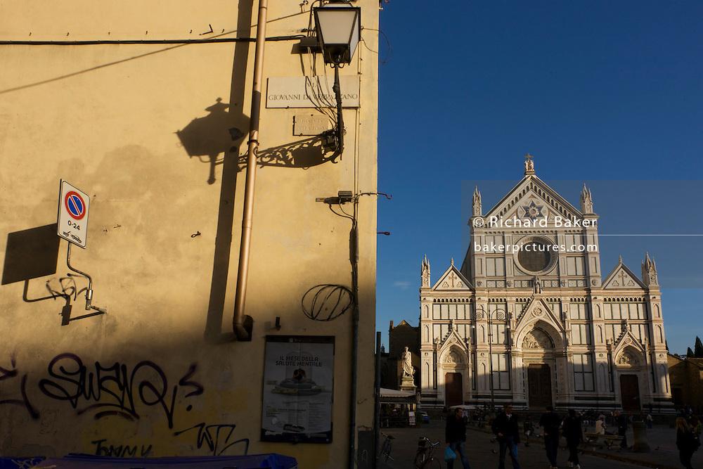 Graffiti street corner and tourist kiosk near Florence's Piazza Santa Croce.