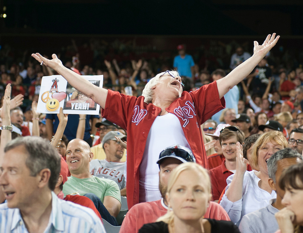 """Fans dance to """"YMCA"""" during 70's Night at Angel Stadium on Friday.<br /> <br /> ///ADDITIONAL INFO:   <br /> <br /> angels.0716.kjs  ---  Photo by KEVIN SULLIVAN / Orange County Register  -- 7/15/16<br /> <br /> The Los Angeles Angels take on the Chicago White Sox at Angel Stadium."""