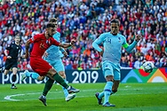 Portugal midfielder Bruno Fernandes (16) shoots towards the goal during the UEFA Nations League match between Portugal and Netherlands at Estadio do Dragao, Porto, Portugal on 9 June 2019.