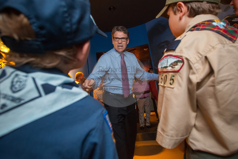 Former Texas Governor and GOP presidential hopeful Rick Perry speaks to a group of Boy Scouts before holding a town hall aboard the USS Yorktown in Mount Pleasant, South Carolina.
