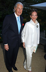 MARTIN & ANNE SUMMERS at the Cartier Chelsea Flower Show dinat the annual Cartier Flower Show Diner held at The Physics Garden, Chelsea, London on 23rd May 2005.<br />