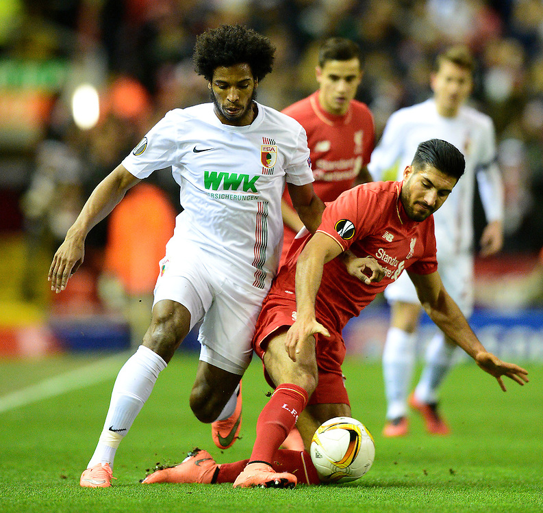 Liverpool's Emre Can battles with Augsburg's Caiuby<br /> <br /> Photographer Richard Martin-Roberts/CameraSport<br /> <br /> Football - UEFA Europa League Round of 32 - Liverpool v Augsburg - Thursday 25th February 2016 - Anfield - Liverpool<br /> <br /> © CameraSport - 43 Linden Ave. Countesthorpe. Leicester. England. LE8 5PG - Tel: +44 (0) 116 277 4147 - admin@camerasport.com - www.camerasport.com