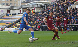Matt Godden of Peterborough United shoots at goal while under pressure from Anthony O'Connor of Bradford City - Mandatory by-line: Joe Dent/JMP - 09/03/2019 - FOOTBALL - Northern Commercials Stadium - Bradford, England - Bradford City v Peterborough United - Sky Bet League One