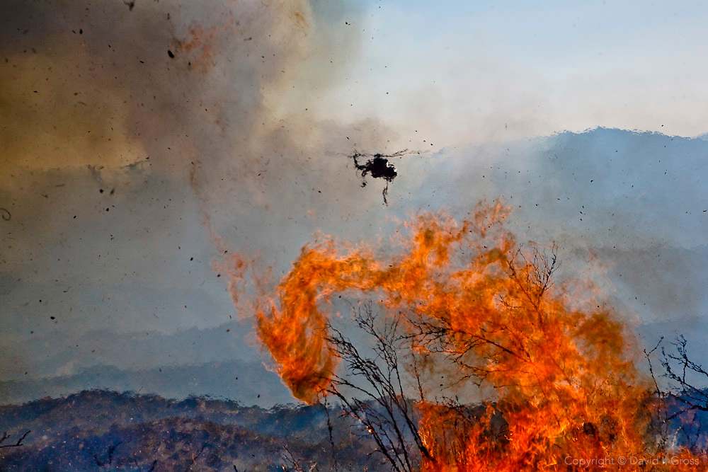 A fire fighting helicopter heads back to base for more retardant after a drop at the La Brea fire in California.