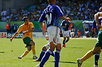 Photo: Glyn Thomas.<br />Australia v Japan. Group F, FIFA World Cup 2006. 12/06/2006.<br />Australia's Tim Cahill (L) scores his and his team's second goal.