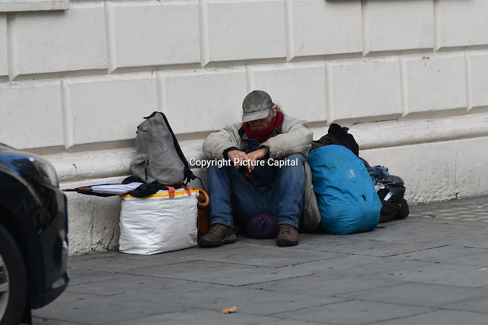A homeless man sitting at the corner of St Martin-in-the-Fields Westend, London, UK. 23 September 2018.