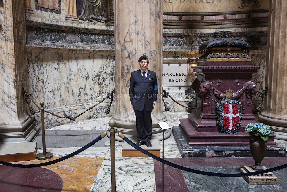 ROME, ITALY - 29 JULY 2014: Captain Ugo d'Atri, President of the National Institute for the Honor Guards to the royal tombs of the Pantheon, stands here by the tomb of King Victor Emmanuel II  in Rome, Italy, on July 29th 2014.<br /> <br /> The National Institute for the Honor Guards to the royal tombs of the Pantheon is a monarchic-oriented whose goal is to watch over the royal tombs at the Pantheon. Italy's first king, Vittorio Emanuele II and his son Umberto I, as well as Umberto's wife Queen Margherita are entombed in the Pantheon.