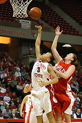 28 January 2007: Tamara Butler shoots a short shot. Kelly Krumwiede ties to block from the back. Before a record crowd or nearly 4200, the Bradley Braves were defeated by the conference leading (9-0) Redbirds of Illinois State University by a score of 55-47 at Redbird Arena in Normal Illinois.