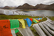 Prayer flags at the Sichen Holy Lake near Ruthok, Tibet. 4,900 meters altitude, in Maldro Gunkar County.