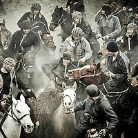 Ros, Uzbekistan 18 March 2012<br /> Buzkashi contest.<br /> The Buzkashi is a traditional Central Asian team sport played on horseback in Uzbekistan, Afghanistan, Tajikistan, Kyrgyzstan, Turkmenistan, northern Pakistan, Xinjiang Uyghur Autonomous Region of China and Kazakhstan. <br /> The steppes' people were skilled riders who could grab a goat or calf from the ground while riding a horse at full gallop. The goal of a player is to grab the carcass of a headless goat or calf and then get it clear of the other players and pitch it across a goal line or into a target circle or vat.<br /> PHOTO: EZEQUIEL SCAGNETTI