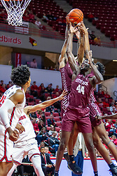 NORMAL, IL - November 10:  A trio of Torjans bring down a defensive rebound including Ruot Monyyong during a college basketball game between the ISU Redbirds and the Little Rock Trojans on November 10 2019 at Redbird Arena in Normal, IL. (Photo by Alan Look)