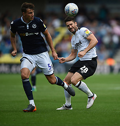 Derby County's David Nugent and Millwall's Jake Cooper