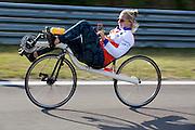 Lieske Yntema rijdt haar warming up rondjes op de baan. Het Human Power Team Delft en Amsterdam (HPT), dat bestaat uit studenten van de TU Delft en de VU Amsterdam, is in Senftenberg voor een poging het laagland sprintrecord te verbreken op de Dekrabaan. In september wil het HPT daarna een poging doen het wereldrecord snelfietsen te verbreken, dat nu op 133 km/h staat tijdens de World Human Powered Speed Challenge.<br /> <br /> Liekse Yntema is warming up at the track. With the special recumbent bike the Human Power Team Delft and Amsterdam, consisting of students of the TU Delft and the VU Amsterdam, is in Senftenberg (Germany) for the attempt to set a new lowland sprint record on a bicycle. They also wants to set a new world record cycling in September at the World Human Powered Speed Challenge. The current speed record is 133 km/h.
