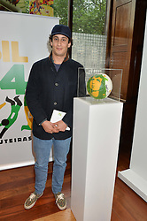 ALEX DELLAL at the Art of Futebol - a charity auction of 11 footballs signed by 11 Brazilian legends from Pele to Neymar & decorated and designed by 11 leading contemporary artists in aid of Action for Brazil's Children Trust held at the Brazilian Embassy, 16 Cockspur Street, London on 10th July 2014.