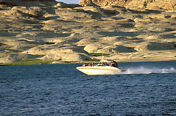 AZ, Arizona Lake Powell, near Grand Canyon National Park, scenic, power boat with Utah border in background, sunset .Photo Copyright: Lee Foster, lee@fostertravel.com, www.fostertravel.com, (510) 549-2202.Image: azlkpo209