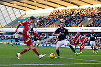 Middlesbrough's Patrick Bamford gets a cross in despite the attentions of Millwall's Byron Webster<br /> <br /> Photographer Craig Mercer/CameraSport<br /> <br /> Football - The Football League Sky Bet Championship - Millwall v Middlesbrough - Saturday 6th December 2014 - The Den - London<br /> <br /> © CameraSport - 43 Linden Ave. Countesthorpe. Leicester. England. LE8 5PG - Tel: +44 (0) 116 277 4147 - admin@camerasport.com - www.camerasport.com