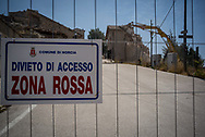A fence at the entrance of the village of Castelluccio di Norcia delimitates the red zone, the area were no one exept fire fighters and rescue team are allowed to enter.