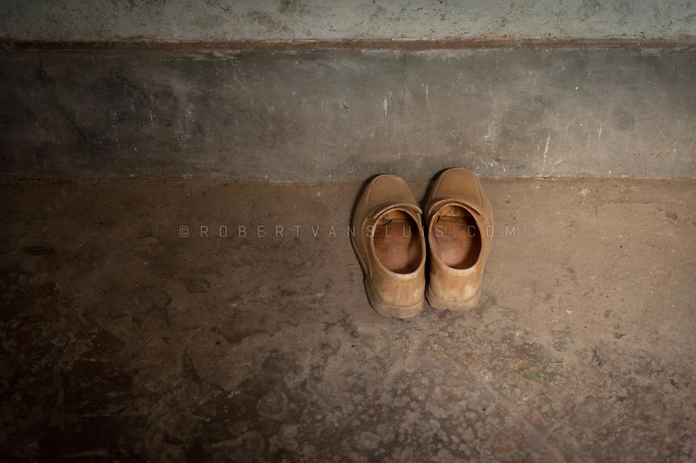 A pair of shoes of a resident at Kashi Labh Mukti Bhawan hospice, Varanasi, India. Photo © robertvansluis.com