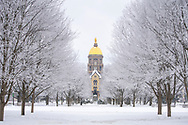 The Golden Dome on a snowy day on the Notre Dame campsu.