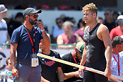 Kevin Mayer (FRA), right,  talks with coach Bertrand Valcin during the decathlon at the DecaStar meeting, Saturday, June 23, 2019, in Talence, France. (Jiro Mochizuki/Image of Sport)