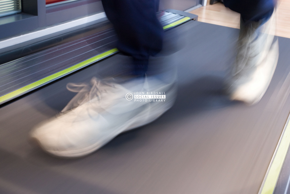 Feet running on a treadmill at a sports leisure centre,