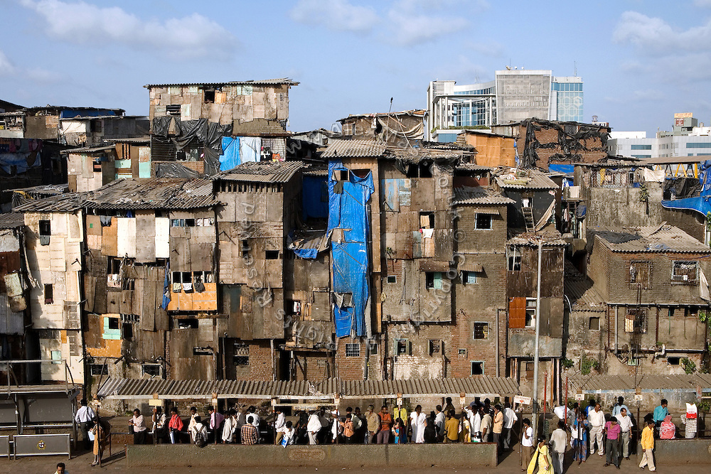 A slum section is photographed from Bandra (East) train station, Mumbai, India. Here, famous child actors Azharuddin Ismail and Rubina Ali, playing the roles of 'young Salim' and 'young Latika' in the movie Slumdog Millionaire, winner of 8 Oscar Academy Awards in December 2008, still live with their families. Various promises were made to lift the two young actors from poverty and slum-life but as of the end of May 2009 anything is yet to happen. Rubina's house was recently demolished with no notice as it lay on land owned by the Maharashtra train authorities and she is now permanently living with her uncle's family in a home a stone-throw away in the same slum. Azharuddin's home too was demolished in the past two weeks, as it happens every year in his case, because the concrete walls were preventing local authorities to clear a drain passing right behind it. As usual, his father is looking into restoring the walls as soon as the work on the drain has been completed.