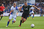 Gavin Reilly (20) of Bristol Rovers battles with Ryan Edwards (5) of Plymouth Argyle during the EFL Sky Bet League 1 match between Bristol Rovers and Plymouth Argyle at the Memorial Stadium, Bristol, England on 8 September 2018.