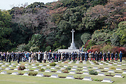 Dignitaries and military personnel gather for a Remembrance Day ceremony at the Yokohama War Cemetery, Hodogaya. Yokohama, Japan. Sunday November 9th 2014