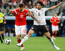June 19, 2018 - Saint Petersburg, Russia - Fedor Smolov (L) of Russia national team and Ahmed Hegazy of Egypt national team vie for the ball during the 2018 FIFA World Cup Russia group A match between Russia and Egypt on June 19, 2018 at Saint Petersburg Stadium in Saint Petersburg, Russia. (Credit Image: © Mike Kireev/NurPhoto via ZUMA Press)