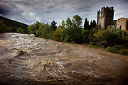 The River Orbeau overflowing its banks and flooding the village on 15th October 2019 in Lagrasse, France. Scientists expect a warming world will lead to more extreme rainfall. Europe and the UK is very likely to see more heavy rainfall by the end of the century.