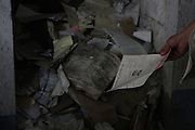 Mounds of arrest files and other documents in deplorable state are still found in National Police Historical Archives. On July 5, 2005, the historical archives of the now dissolved National Police were found in an abandoned arms depot in the outskirts of Guatemala City. The discovery of these millions of documents, which were allegedly lost after the 1996 Peace Accords, provide important evidence in the search for the thousands of people who were detained and subsequently disappeared by State security forces during the internal armed conflict (1960-1996). Guatemala City, Guatemala. August 25, 2010.
