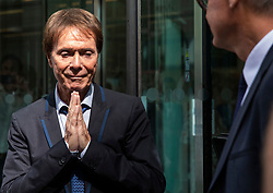 © Licensed to London News Pictures. 18/07/2018. London, UK. An emotional SIR CLIFF RICHARD holds his hands together in prayer as he leaves the Rolls Building of the High Court in London after winning his claim for damages against the BBC for loss of earnings. The 77-year-old singer sued the corporation after his home in Sunningdale, Berkshire was raided following allegations of sexual assault made to Metropolitan Police. Photo credit: Rob Pinney/LNP
