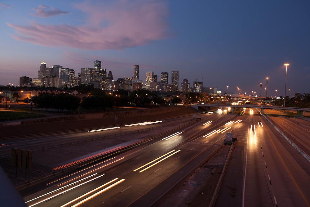 Houston, Texas skyline at twilight with motion blur of traffic lights on the southwest freeway I-59.